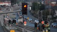 Traffic queueing at roadworks in the city of leeds united kingdom Stock Footage
