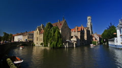 City scape of the canals of Bruges on a sunny day with Belfry in the background. Stock Footage