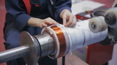 Transformer, engine production. Worker operates with electric cooper wires Arkistovideo