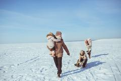 Happy big family walk on a field in winter sunny day Stock Photos
