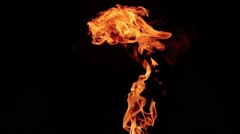 Exploding flame and fire isolated on black background Stock Footage