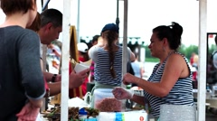 Payment in cash on the street fair, buyers choose the food, shrimp, talk with Stock Footage