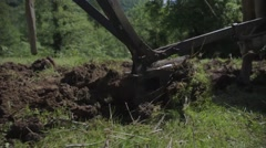 Caucasian farmer plowing with oxen Stock Footage