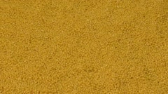 Millet grains falling on a pile of millet Stock Footage