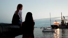 Family meets a dad sailor with swimming, Mom shows daughter on a ship large ship Stock Footage