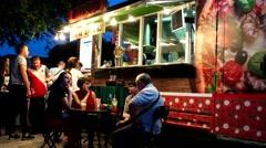 Cozy outdoor cafe van, Restaurant on the street, Visitors eat, pizzeria lit Stock Footage