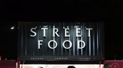 Street food stall selling fast food to take away Stock Footage