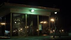 Girls dancing twerk in a public place in a mirror on the night street Stock Footage