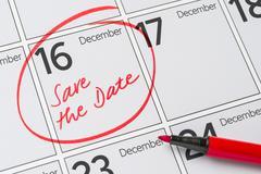 Save the Date written on a calendar - December 16 Stock Photos
