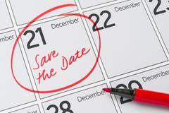 Save the Date written on a calendar - December 21 Stock Photos