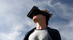 Man outside using Virtual Reality headset Stock Footage