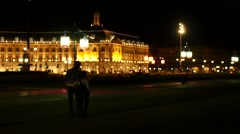 Couple walking  hand in hand near the Place de la Bourse at night Stock Footage