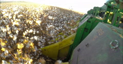 Camera mounted on a cotton picker working in a field Stock Footage