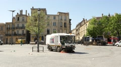 City garbage cleaning trucks driving  - Quartier Saint-Michel Stock Footage