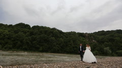 Nice young couple near the river Stock Footage