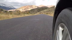 POV front wheel car tire mountain road slow HD Stock Footage