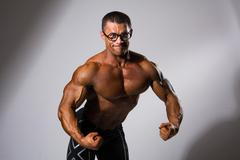 Happy muscular man with a naked torso Stock Photos