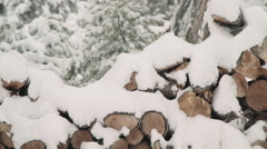 Stacked Firewood with Snow Accumulation Stock Footage