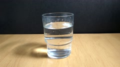 In a glass of water  throw effervescent tablet Stock Footage