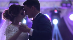 Newlywed couple hugging and dancing on their wedding day Stock Footage