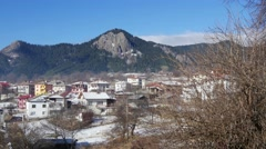 Mountain village with peaks in the background Stock Footage