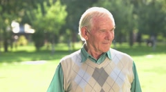 Senior man touching his chin. Stock Footage