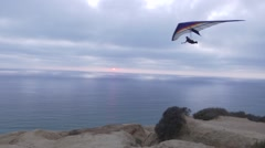 Sunset on the coast with a Hang Glider Arkistovideo