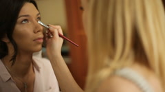 Stylist makes makeup bride on the wedding day Stock Footage