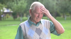 Senior man holding his forehead. Stock Footage