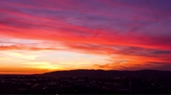 Sunset timelapse showing the hills and the lights of the city lighting up. Stock Footage
