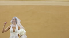 Wedding bride smiling handing the bouqet Stock Footage