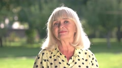 Older woman is smiling. Stock Footage