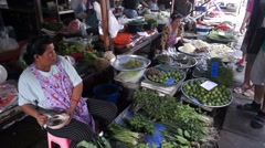 Vendor sells fresh local agricultural production Stock Footage