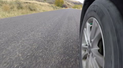 Driving car POV front wheel rural mountain road HD Stock Footage