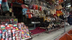 Local peoples sell fruits, food and souvenirs at famous tourist attraction Stock Footage
