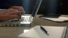 Close-up of lap-top computer and a man typing something on it Stock Footage