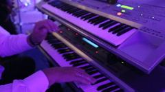 Musician playing electronic piano in restaurant Stock Footage