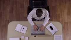 Businessman becomes excited after finishing his work Stock Footage