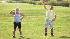Senior couple does exercise. Stock Footage