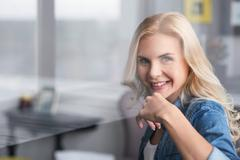 Close up of smiling blond woman Stock Photos