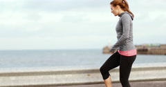 Young adult female stretching outdoors Stock Footage