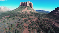 Aerial Camera Slowly Rising Looking At Court House Butte- Sedona AZ Stock Footage