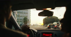 4K Romantic couple in car share a kiss as they drive through the city Stock Footage