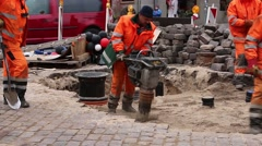 Riga, Latvia: Workers repairing the road Stock Footage