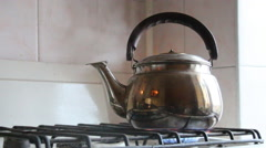Simmering whistling kettle on the old stove Stock Footage