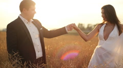 Happy bride dancing near her groom at the wheat field Stock Footage