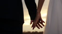 Newly married couple holding hands Stock Footage