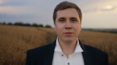 Portrait of a young groom at the field Stock Footage