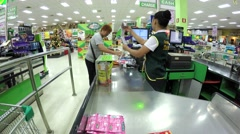 Shopping Mature Woman at check out counter At The Grocery Store. Arkistovideo