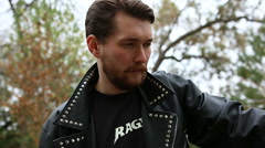 Handsome bearded man in black leather jackets Stock Footage
